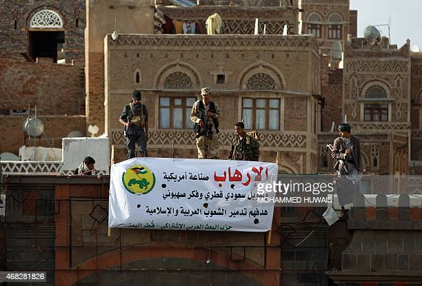 Huthi movement fighters stand guard atop a building in the capital Sanaa on April 1 during a demonstration against Saudiled coalitions Operation...