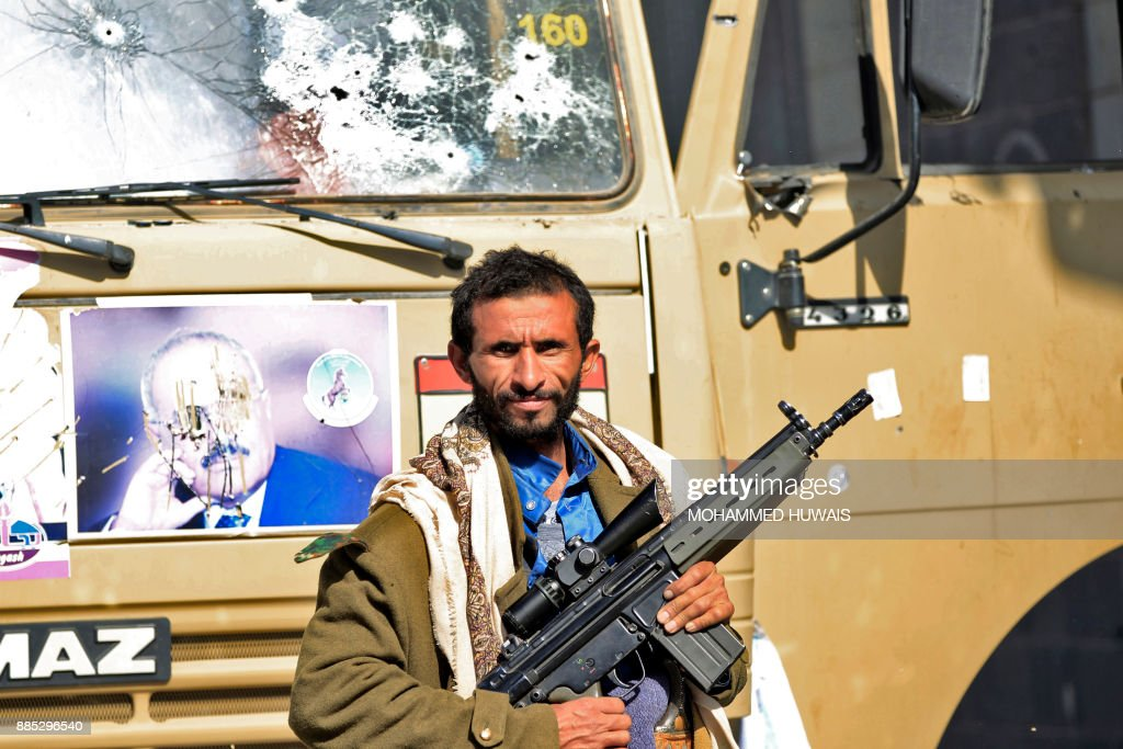 A Huthi rebel fighter is seen outside of the residence of Yemen's former President Ali Abdullah Saleh in Sanaa on December 4, 2017. Yemen's rebel-controlled interior ministry announced on December 4 the 'killing' of the ex-president, as a video emerged showing what appeared to be Saleh's corpse. /