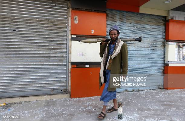 Huthi rebel fighter is seen with a rocket propelled grenade in front of the residence of Yemen's former President Ali Abdullah Saleh in Sanaa on...