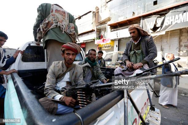 Huthi rebel fighters are seen riding an armoured vehicle in front of the residence of Yemen's former President Ali Abdullah Saleh in Sanaa on...