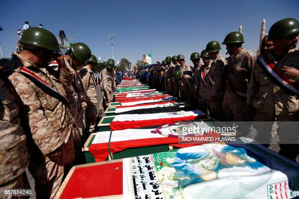 TOPSHOT Huthi supporters attend the funeral of those killed during recent clashes between Huthi rebel fighters and loyalists of Yemen's late...