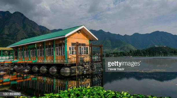 A hutment floats on the waters of Dal lake on July 19 2018 in Srinagar the summer capital of Indian administered Kashmir India Kashmir the Muslim...