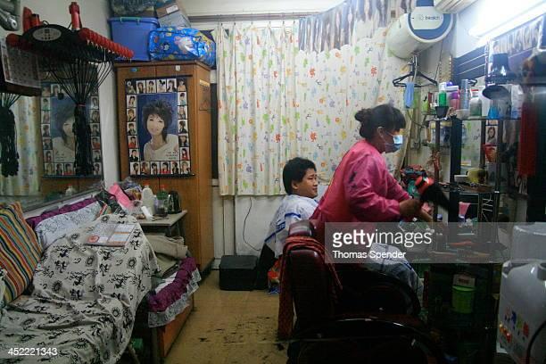 CONTENT] A hutong hairdresser in Beijing's Dongcheng district