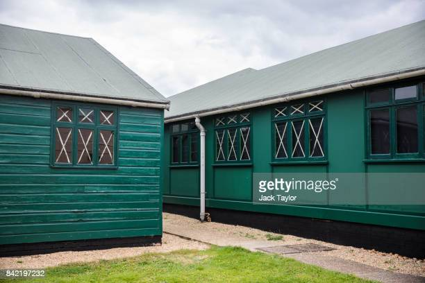 Huts in Bletchley Park used by codebreakers during World War II stand during an annual reunion event of veterans who worked at Bletchley Park and its...