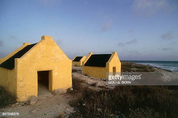 Huts of slaves along the coast, Island of Bonaire, Netherlands Antilles.