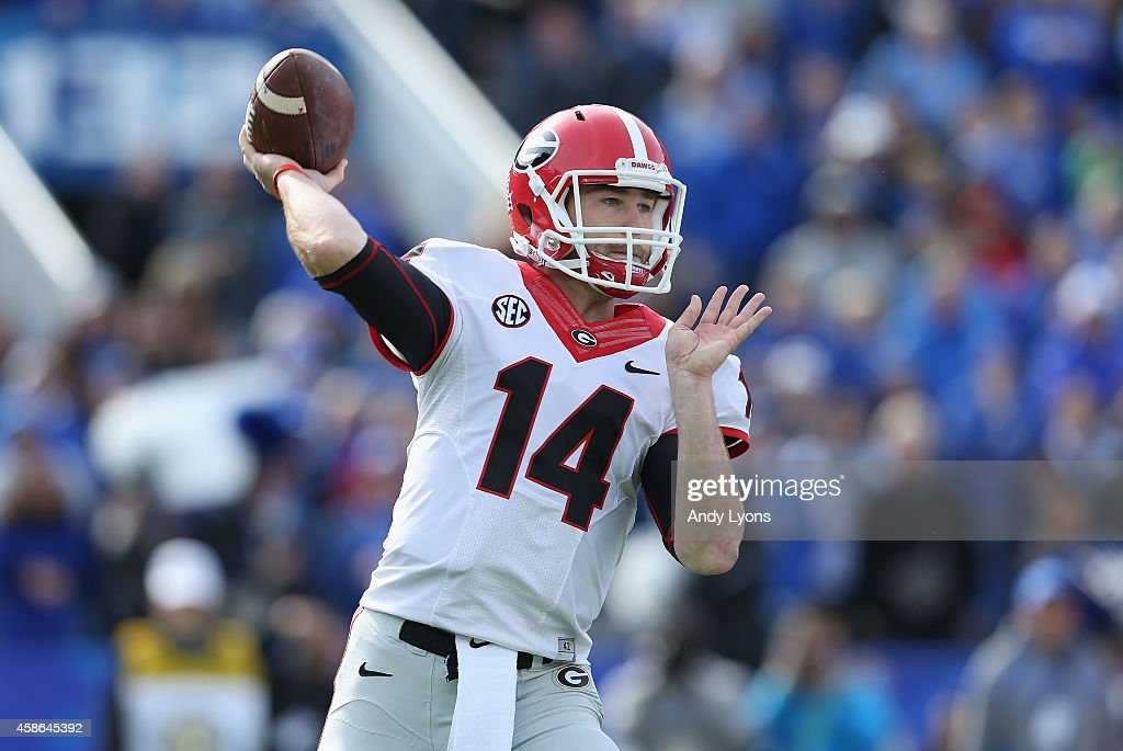 Hutson Mason #14 of the Georgia Bulldogs throws a pass during the game against the Kentucky Wildcats at Commonwealth Stadium on November 8, 2014 in Lexington, Kentucky.