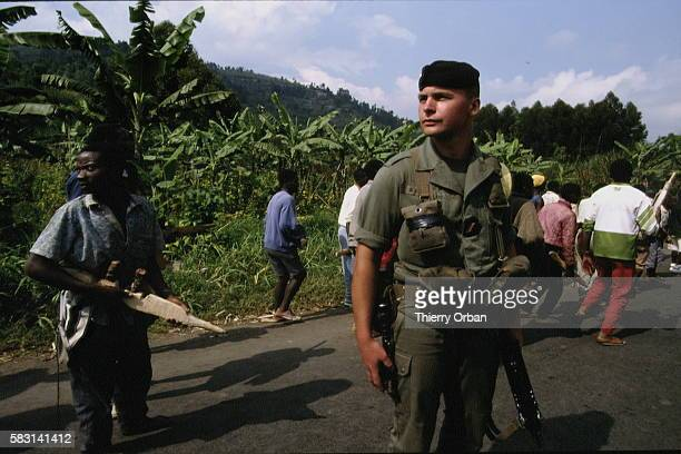 Hutu volunteer soldiers anxious and often intoxicated undergo military training in ordre profond and in marching in formation equipped with mock...