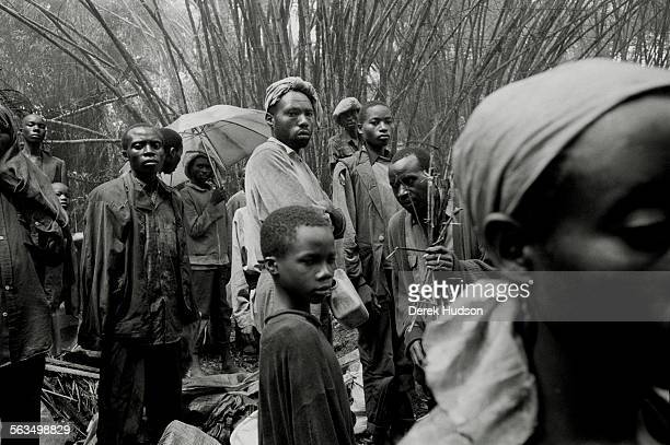 Hutus refugees stop to shelter from torrential rains as they walked towards the town of Ubundu having crossed the Congo river north of Kisangani...