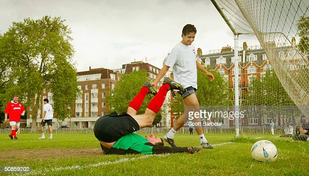 Huw Edwards British member of parliament and goalkeeper for the Parliamentary Football team takes a tumble after conceding a goal to the National...