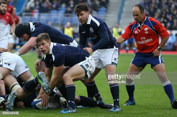 Huw Jones Ali Price of Scotland in action while referee Jaco Peyper of South Africa looks on during the RBS 6 Nations tournament match between France...