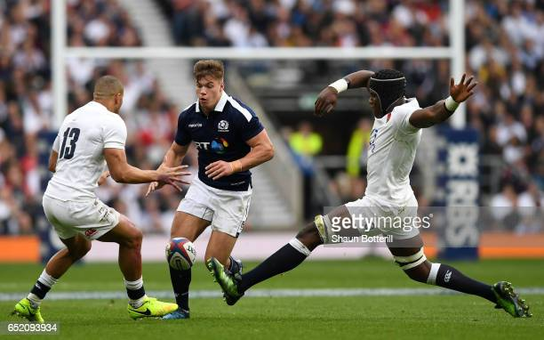 Huw Jones of Scotland attempts to get past Jonathan Joseph of England and Maro Itoje of England during the RBS Six Nations match between England and...