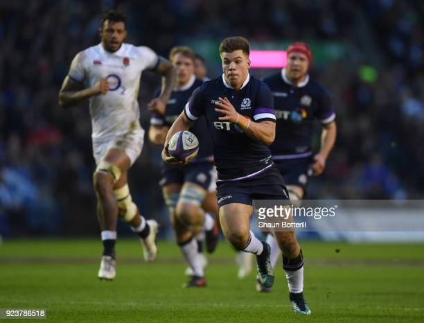 Huw Jones of Scotland breaks away to score the third try during the NatWest Six Nations match between Scotland and England at Murrayfield on February...