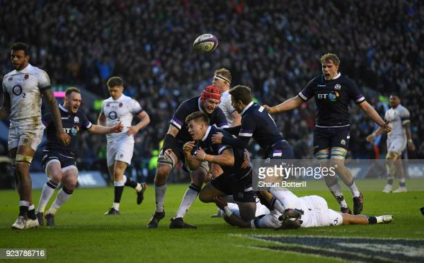 Huw Jones of Scotland is congratulated on scoring the third try during the NatWest Six Nations match between Scotland and England at Murrayfield on...