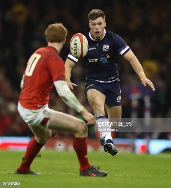 Huw Jones of Scotland kicks the ball upfield during the NatWest Six Nations match between Wales and Scotland at the Principality Stadium on February...