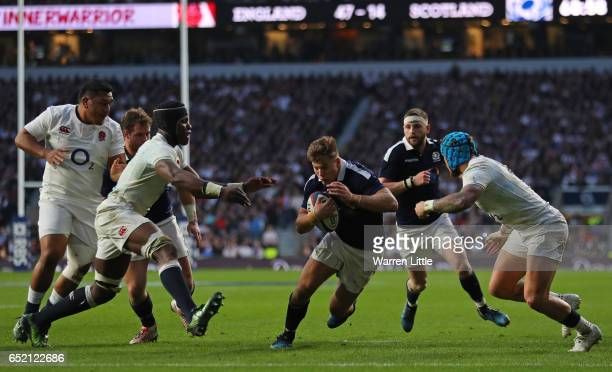 Huw Jones of Scotland scores his sides third try during the RBS Six Nations match between England and Scotland at Twickenham Stadium on March 11 2017...