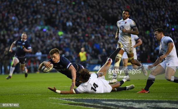 Huw Jones of Scotland scores the third try under pressure from Anthony Watson of England during the NatWest Six Nations match between Scotland and...