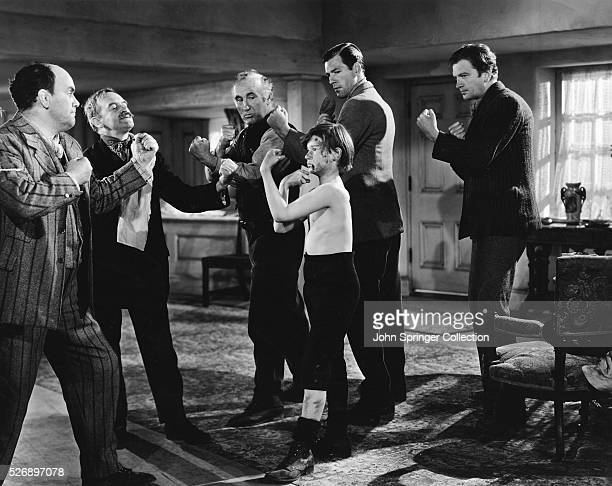 Huw Morgan gets a lesson in how to fight in the 1941 film How Green Was My Valley Rhys Williams as prize fighter Dai Bando Barry Fitzgerald as...