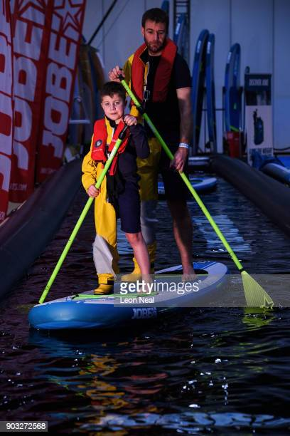 Huw Williams and his son Steffan pose in symbolic halflifeguard/halfcasual clothing to protest the RNLI's decision to downgrade New Quay lifeboat...