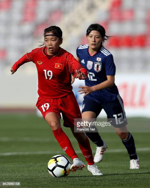 Huynh Nhu of Vietnam and Hikaru Naomoto of Japan in action during the AFC Women's Asian Cup Group B match between Japan and Vietnam at the King...