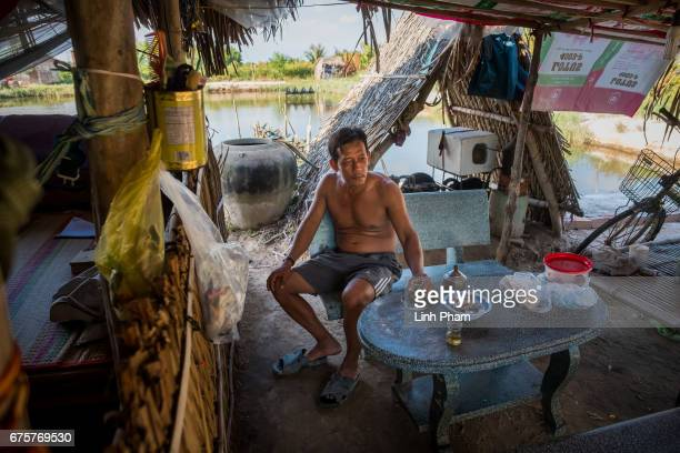 Huynh Van Han 41 a shrimp farmer enjoys tea with water taken from his rain water storage on April 28 2017 in Binh Chanh Village Binh Dai District Ben...