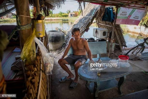 Huynh Van Han 41 a shrimp farmer enjoys tea with water taken from his rain water storage on April 28 2017 in Binh Chanh Village Binh Dai District Ben...