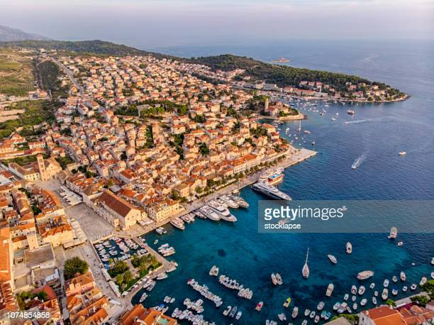 hvar city harbor at sunset light - hvar stock photos and pictures