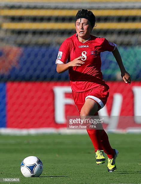 Hwa Myong Jon of Korea DPR runs with the ball during the FIFA U20 Women's World Cup 2012 group C match between Korea DPR and Norway at Kobe...
