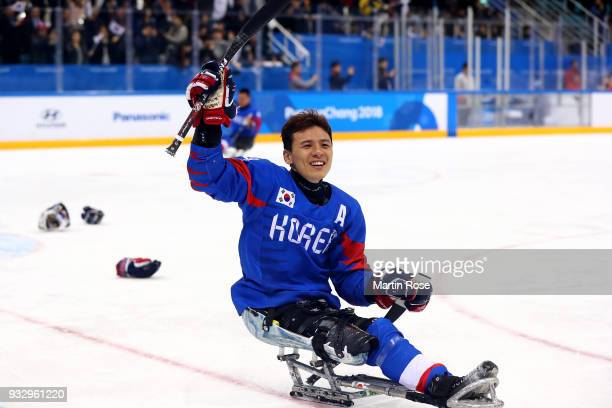 Hwan Seung Jung of Korea celebrates after winning the bronze medal over Italy in the Ice Hockey bronze medal game between Korea and Italy during day...
