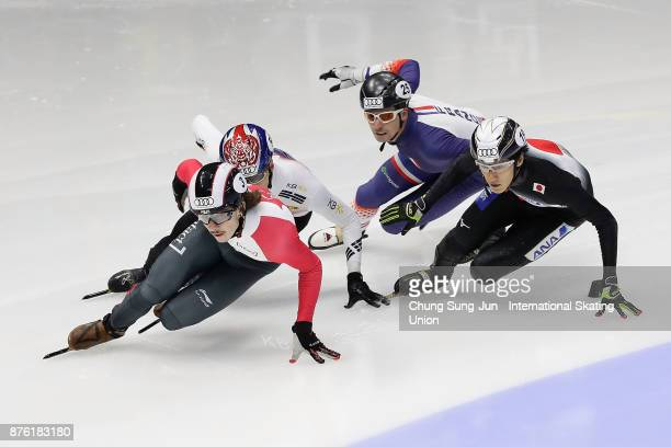 Hwang DaeHeon of South Korea Tianyu Han of China and Keith Watanabe of Japan compete in the Men 1000m Quarterfinals during during the Audi ISU World...