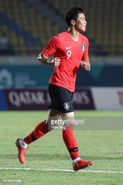 Hwang Hee Chan of South Korea celebrates for scoring his team's 6th goal during the Men's Football Group E match between South Korea and Bahrain at...