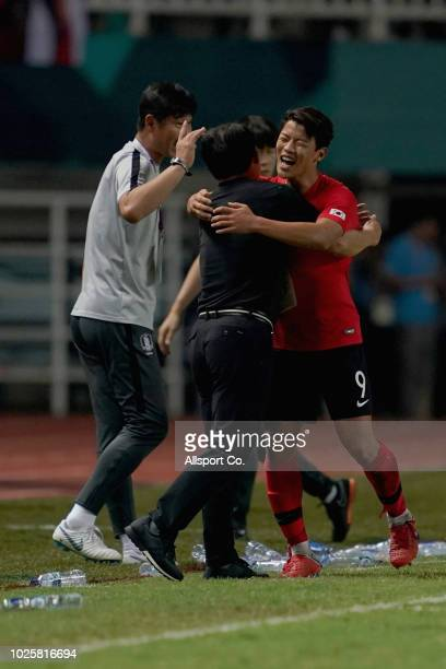 Hwang Hee Chan of South Korea celebrates with his coach after scoring the second goal of his team against Japan during the Men's Football gold medal...