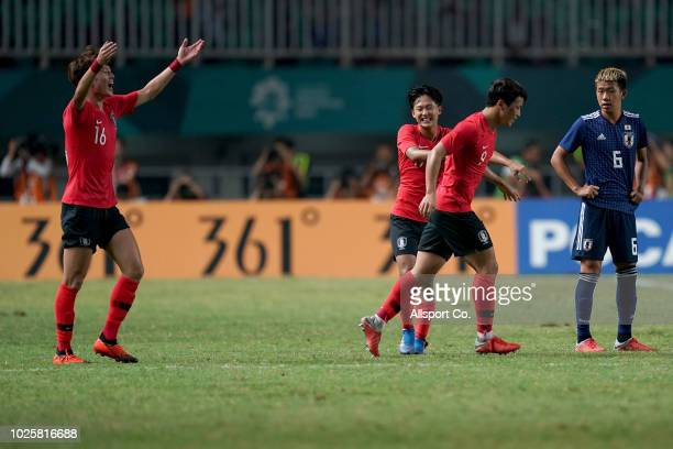 Hwang Hee Chan of South Korea celebrates with teammates after he scoring the second goal of his team against Japan during the Men's Football gold...