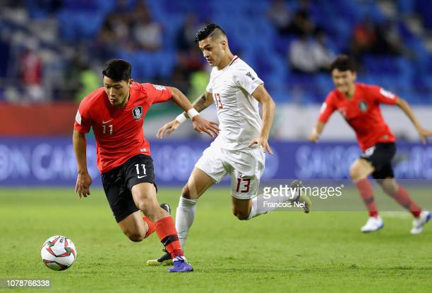 Hwang Hee Chan of South Korea competes for the ball with Adam Tull of the Philippines during the AFC Asian Cup Group C match between South Korea and...