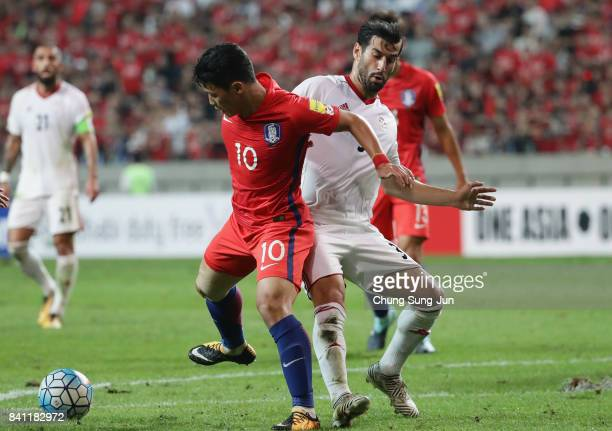 Hwang Hee Chan of South Korea controls the ball under pressure of Ehsan Haji Safi of Iran during the FIFA World Cup Russia Asian qualifier match...