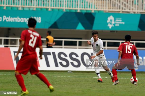 Hwang Hee Chan of South Korea passes the ball during the Men's Footbal semi final competition between Vietnam and South Korea held at the Pakan Sari...