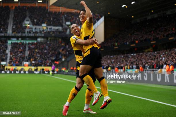 Hwang Hee-chan celebrates with Marcal of Wolverhampton Wanderers after scoring their team's second goal during the Premier League match between...