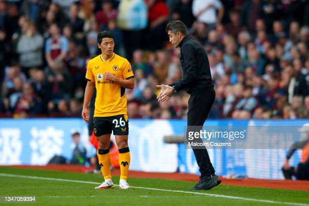 Hwang Hee-Chan in conversation with Wolverhampton Wanderers manager Bruno Lage during the Premier League match between Aston Villa and Wolverhampton...