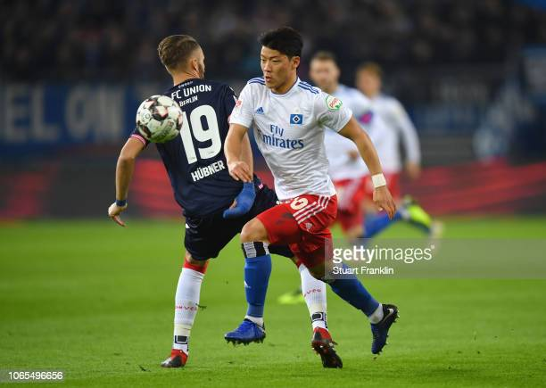 Hwang HeeChan of Hamburg battles for possession with Florian Huebner of FC Union Berlin during the Second Bundesliga match between Hamburger SV and 1...