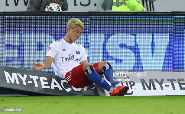 Hwang HeeChan of Hamburg sits injured on the advertising during the Second Bundesliga match between Hamburger SV and SpVgg Greuther Fuerth at...