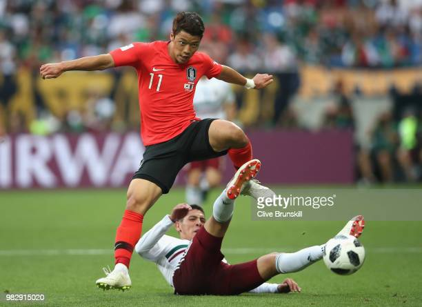 Hwang Heechan of Korea Republic is tackled by Edson Alvarez of Mexico during the 2018 FIFA World Cup Russia group F match between Korea Republic and...
