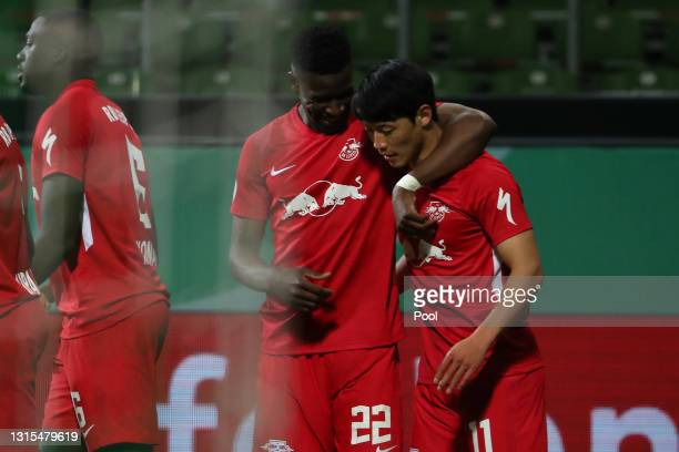 Hwang Hee-chan of RB Leipzig celebrates with Nordi Mukiele after scoring his team's first goal during the DFB Cup semi final match between Werder...