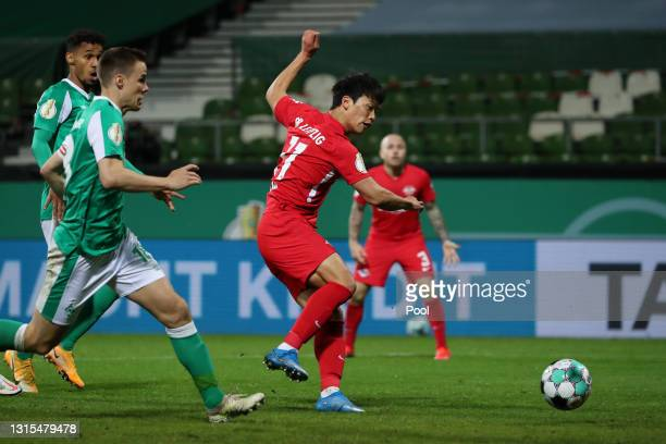 Hwang Hee-chan of RB Leipzig scores his team's first goal during the DFB Cup semi final match between Werder Bremen and RB Leipzig at Weserstadion on...