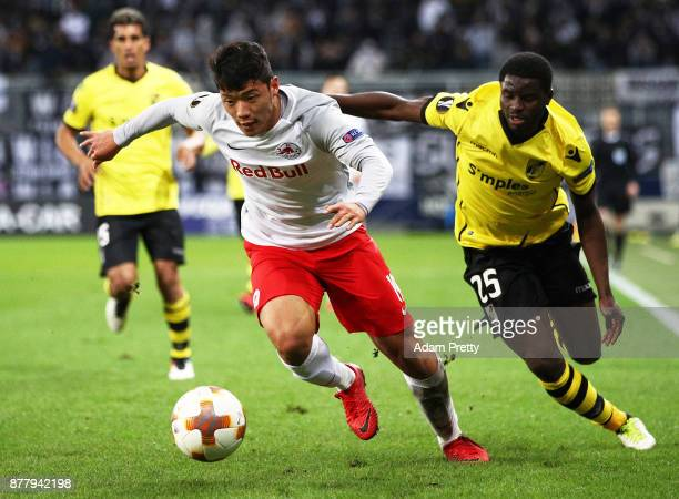 Hwang Heechan of Red Bull Salzburg is challenged by Alhassan Wakaso of Vitoria Guimaraes during the UEFA Europa League group I match between FC...