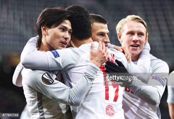 Hwang Heechan of Red Bull Salzburg is congraluated by Takumi Minamino of Red Bull Salzburg after scoring a goal during the UEFA Europa League group I...
