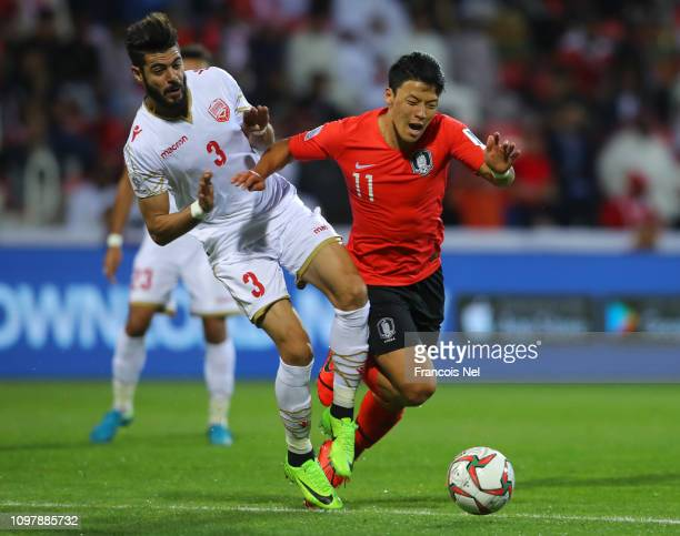Hwang HeeChan of South Korea is challenged by Waleed Al Hayam of Bahrain during the AFC Asian Cup round of 16 match between South Korea and Bahrain...