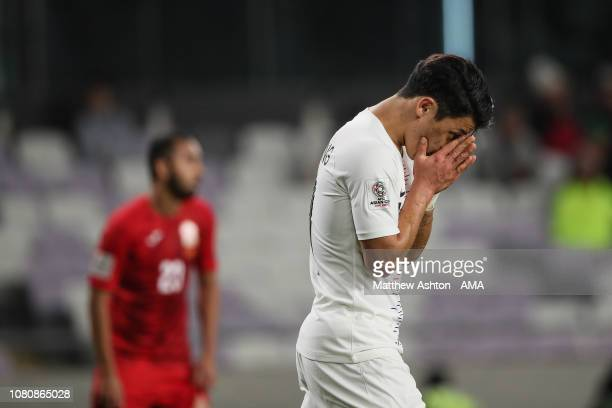 Hwang Heechan of South Korea reacts after missing a chance on goal during the AFC Asian Cup Group C match between Kyrgyz and South Korea at Hazza Bin...