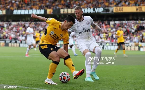 Hwang Hee-chan of Wolverhampton Wanderers is challenged by Pontus Jansson of Brentford during the Premier League match between Wolverhampton...
