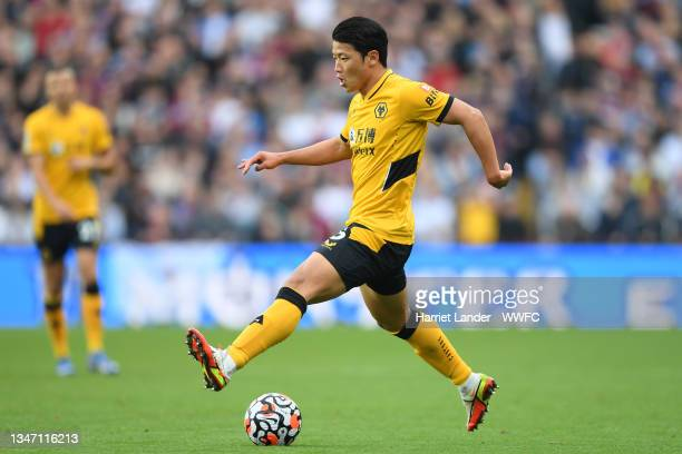 Hwang Hee-chan of Wolverhampton Wanderers runs with the ball during the Premier League match between Aston Villa and Wolverhampton Wanderers at Villa...