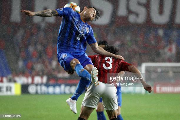 Hwang Il-su of Ulsan Hyundai and Tomoya Ugajin of Urawa Red Diamonds compete for the ball during the AFC Champions League round of 16 second leg...
