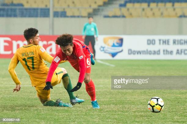 Hwang KiWook of South Korea and Brandon Wilson of Australia compete for the ball during the AFC U23 Championship Group D match between South Korea...